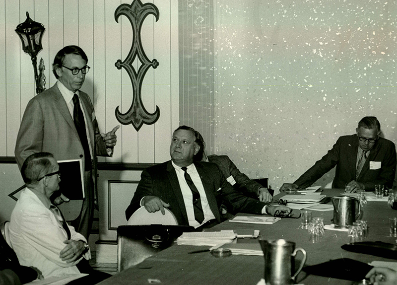 E. G. Hamilton talks to member volunteers at the 1971 Annual Meeting.