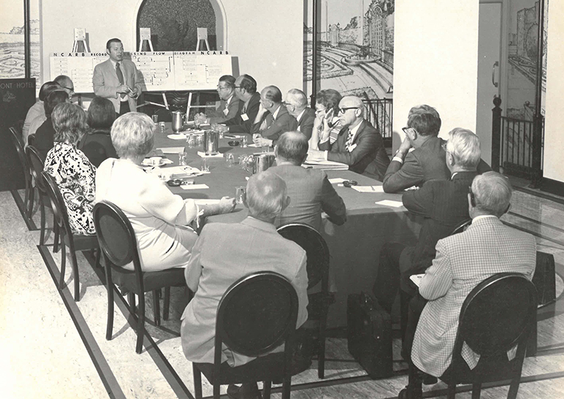 Samuel T. Balen leads a meeting in the 1980s.