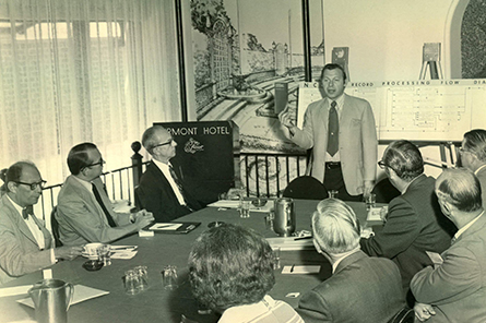 The Certification Committee meets in the 1970s.